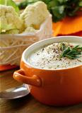 Cream soup of cauliflower with black pepper and parsley
