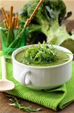 Cream soup  broccoli with arugula greens in a white bowl