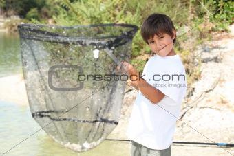 Boy with a huge fishing net