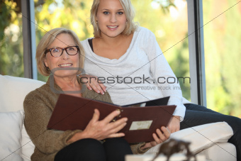 Grandmother and granddaughter looking at pictures