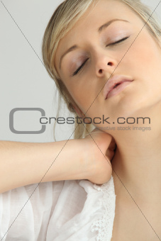 Blond girl with neck ache