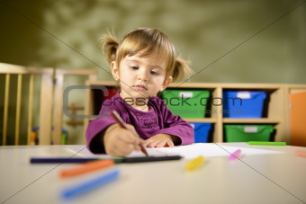 Babies and fun, child drawing at school