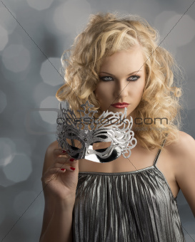 blonde girl with silver mask, looks at left