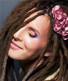 Dreads coiffure. Emotions. Fashion female  hairstyle. Flower