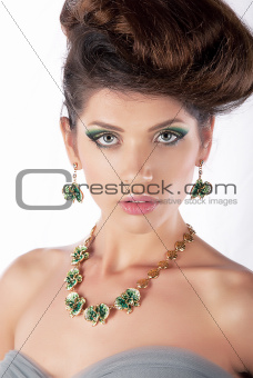 Luxurious hair model beautiful brunette with necklace