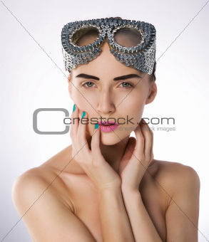Pretty young girl swimmer in unusual metallic protective mask