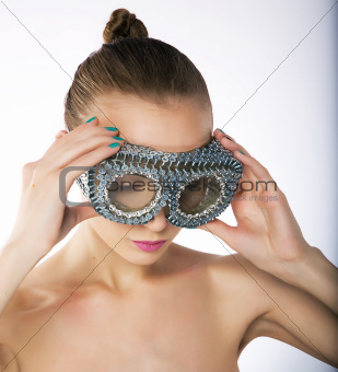 Spectacular young slim woman in metallic silver spectacles