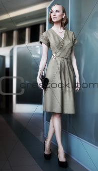 Beautiful slim businesswoman fashion model in office space
