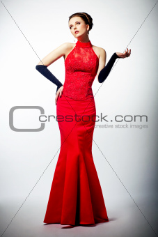 Sensuality. Gorgeous young european bride in red dress
