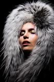 Beautiful young sensual woman in fur fashion collar