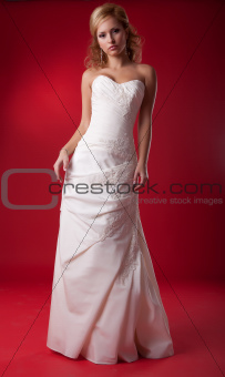 Pretty female - young bride blonde in wedding white dress