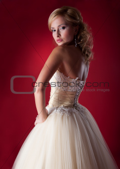 Bride fashion model in white bridal dress posing in studio