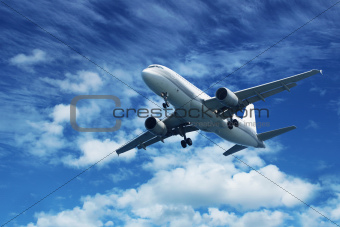 Passenger air plane on blue sky
