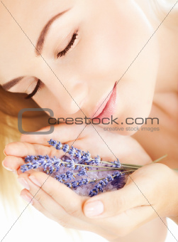 Beautiful girl smell lavender flowers