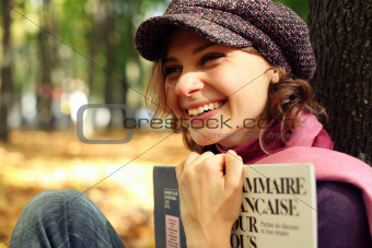 young girl with a French textbook