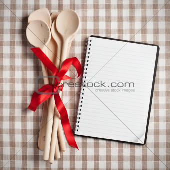 kitchen utensil with blank recipe book