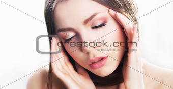 Dreamy beauty - young woman face, natural make-up. Migraine