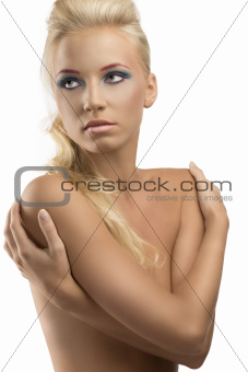 blonde girl with coloured make-up looks at right