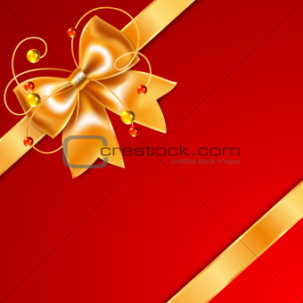 Golden bow of silk ribbon, isolated on red background