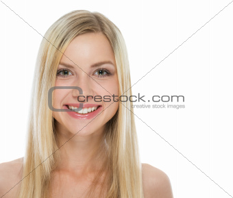 Portrait of blond hair smiling girl on white background