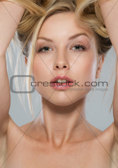 Portrait of blond girl rising up hair