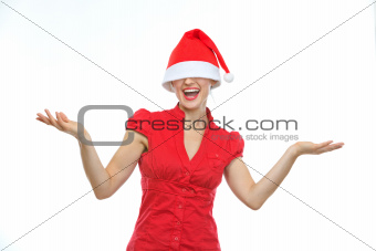 Happy young woman with Christmas hat over eyes shrugs