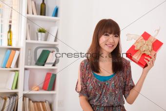 beautiful asian woman happy receiving gift