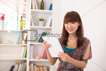 asian woman using tablet computer