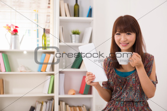 casual asian woman using tablet computer