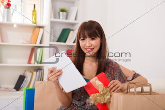 asian girl enjoying online shopping