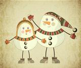 Two snowmen on grunge background