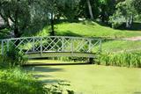 Bridge and pond in the city park. Loviisa in Finland.