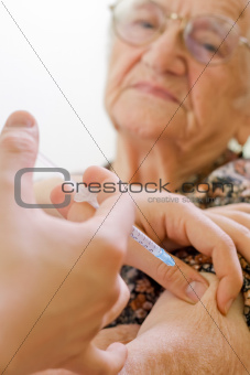 Old woman's injection