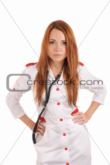 Angry young doctor with hands on hips