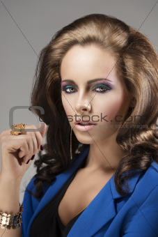 elegant girl with fluffy hair looks in to the lens