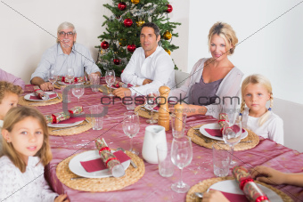 Smiling family at the dinner table at christmas