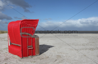 Red beach chair on the North Sea, Germany