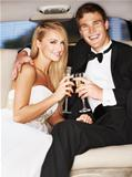 &quot;A young, blissfully happy couple enjoying champagne together in the back of a limousine&quot;