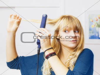 teenager smooting her hair