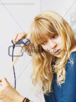 teenager smooting her hair