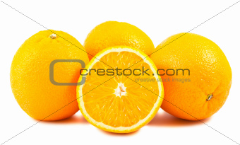 Sliced and whole ripe orange fruits