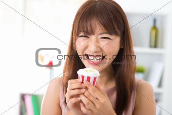 Enjoying cupcake