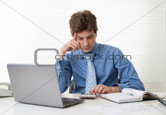 Busy businessman with laptop computer
