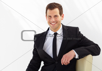 Attractive young professional smiles broadly