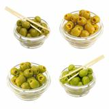 Set green olives in a bowl on a white background