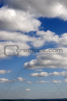 cloudy sky above green fields
