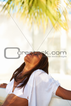 Cropped view of a African American woman sitting and relaxing