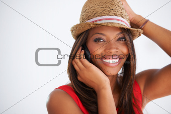 Smiling African American woman on her cellphone