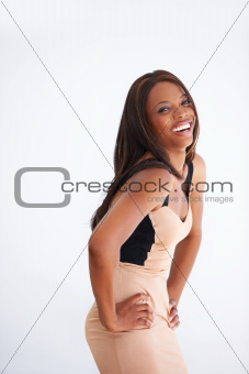 Confident African American woman laughing while isolated on white