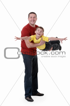 Dad keeps his son in his arms